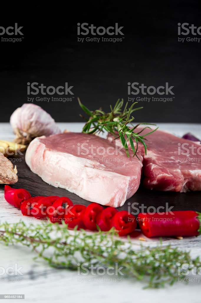 Raw pork meat with spice ingredient royalty-free stock photo