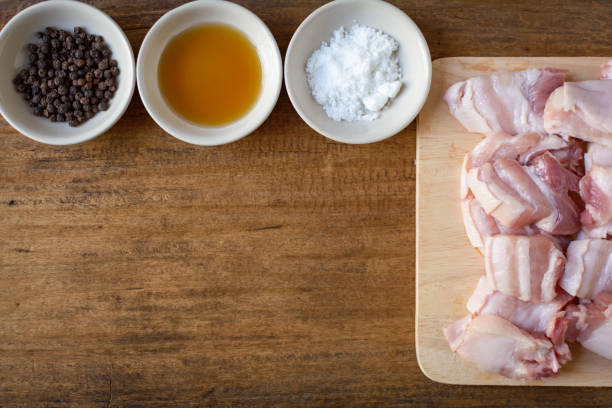 Raw pork on a cutting board wood table background stock photo