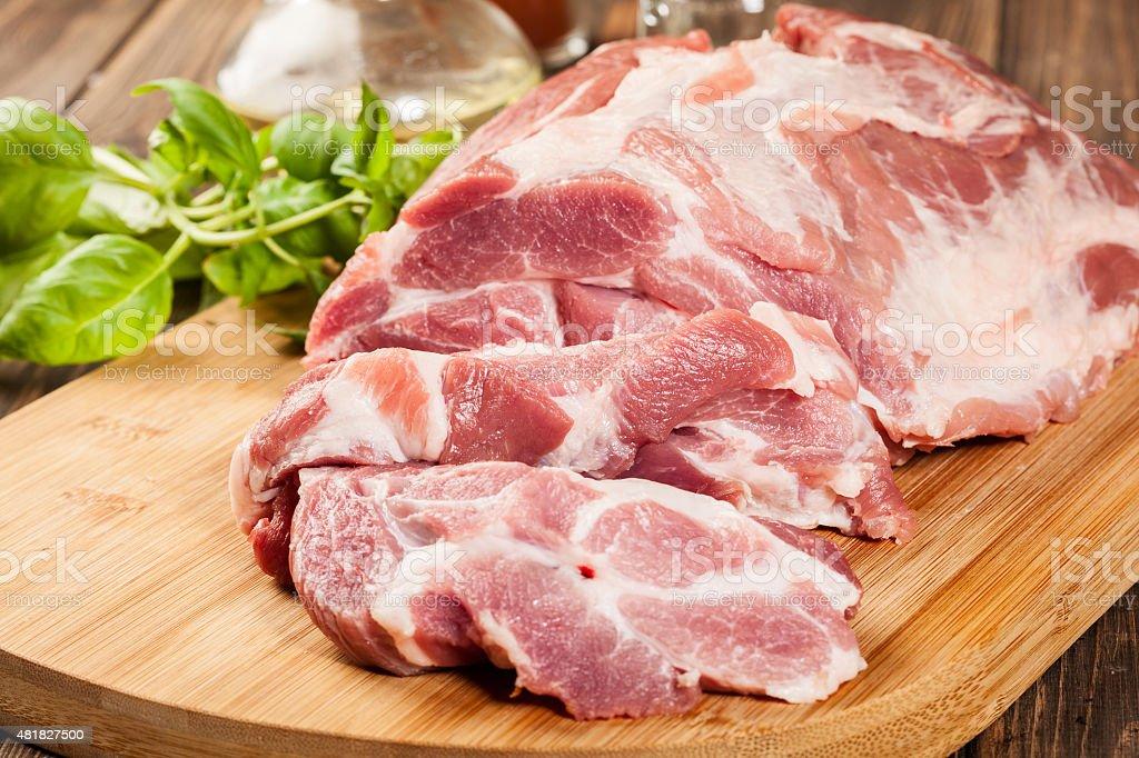 Raw pork on cutting board stock photo