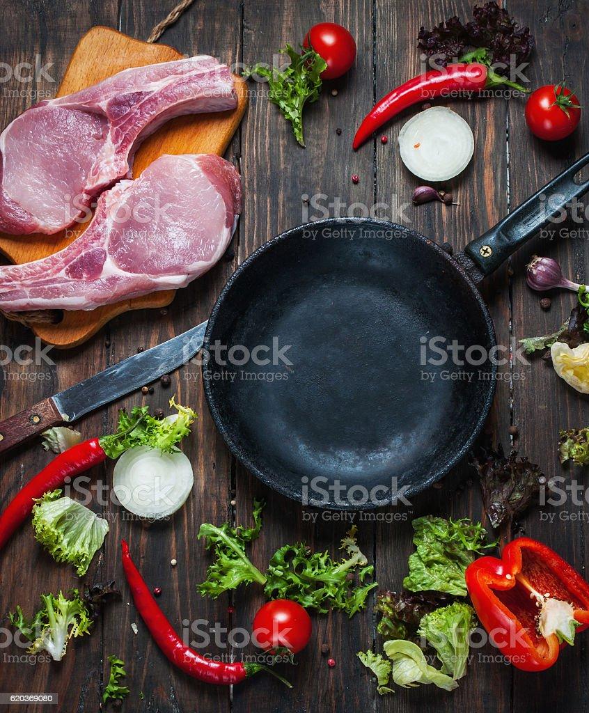 Raw pork steak with herbson wooden rustic background zbiór zdjęć royalty-free