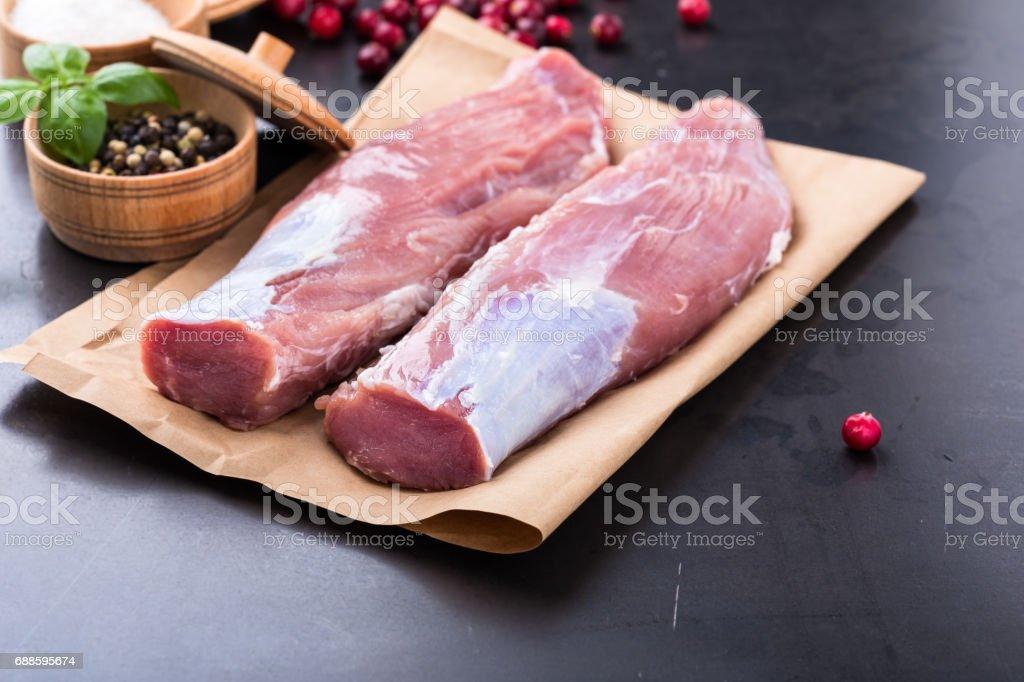 Raw pork tenderloin on craft pape stock photo