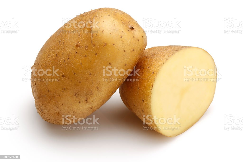 Raw Potato and half potato stock photo
