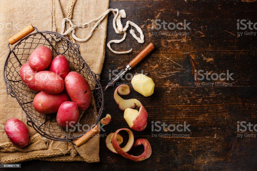 Raw potato in metal basket stock photo