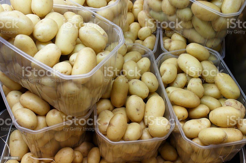 raw potatoes on pot stock photo