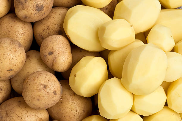 raw potatoes - peeled stock photos and pictures