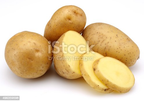 raw potatoes and slices isolated on white background