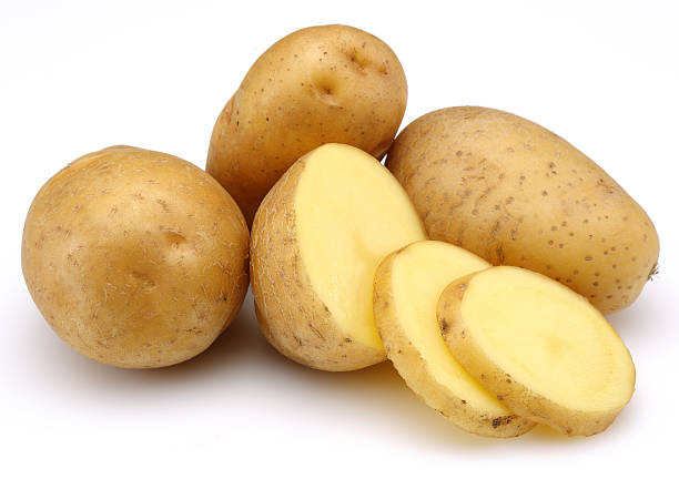 Raw Potatoes with Slices stock photo
