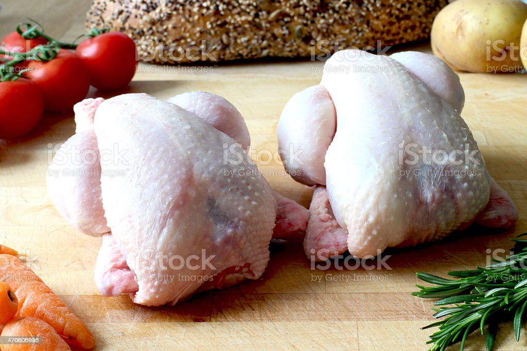 Raw poussin small chicken stock photo