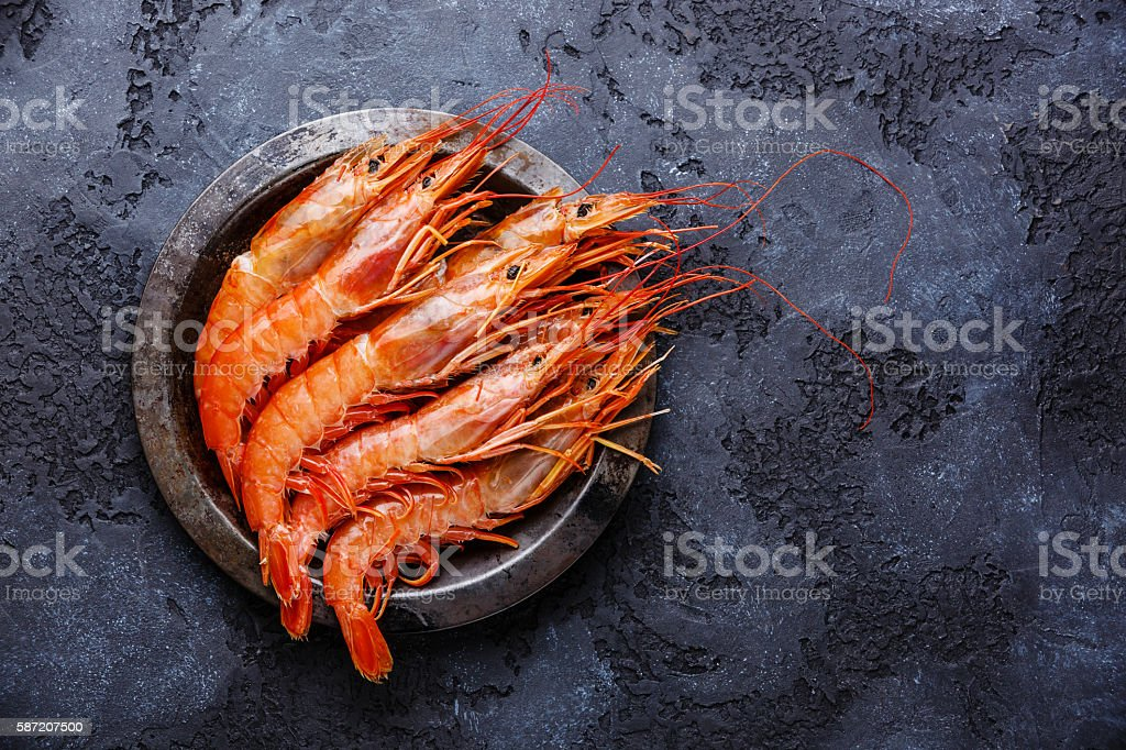 Raw Prawns on metal plate stock photo