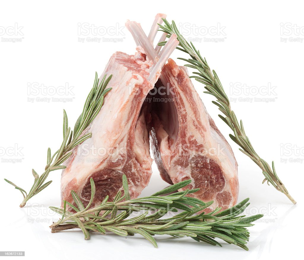 Raw rack of lamb with rosemary, isolated on white royalty-free stock photo