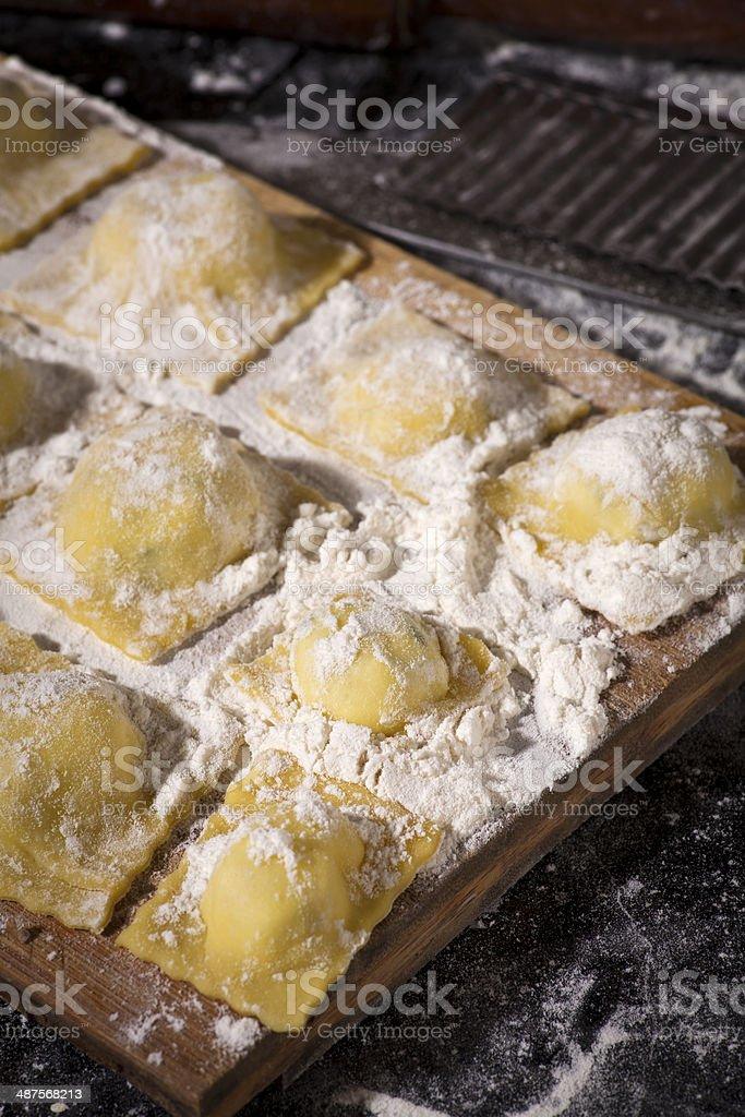 Raw Ravioli pasta on the wooden board stock photo