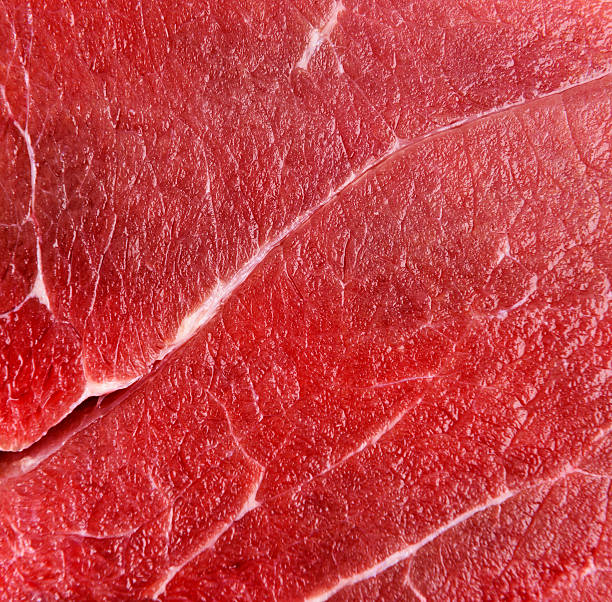 Raw red beef meat macro Raw red beef meat macro texture or background red meat stock pictures, royalty-free photos & images