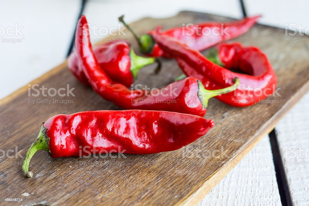 raw red chili pepper on a cutting board, spices royalty-free stock photo