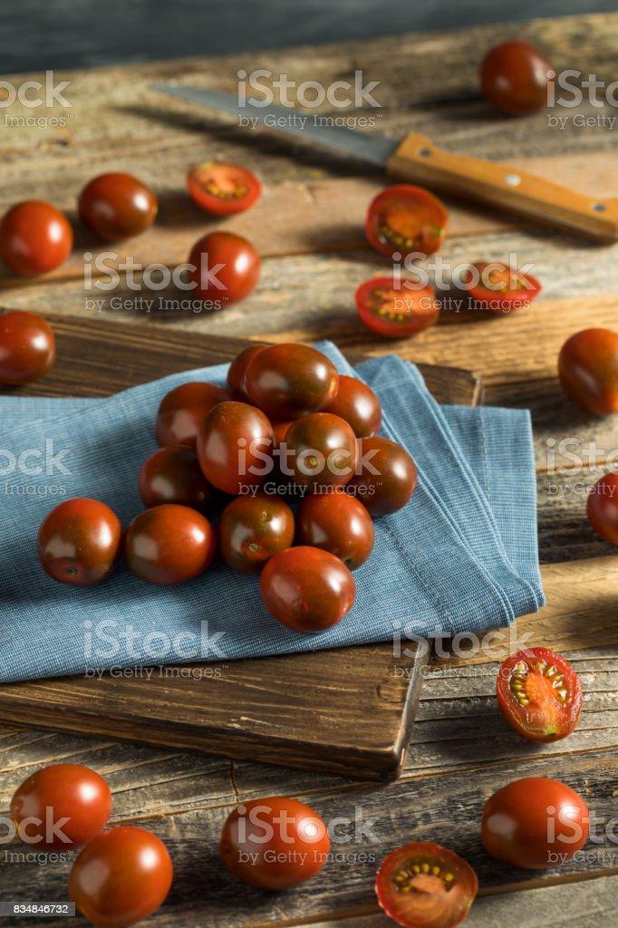 Raw Red Organic Cherry Kamato Tomatoes stock photo