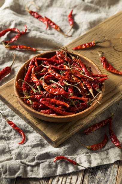 Raw Red Organic Chile de Arbol Peppers stock photo