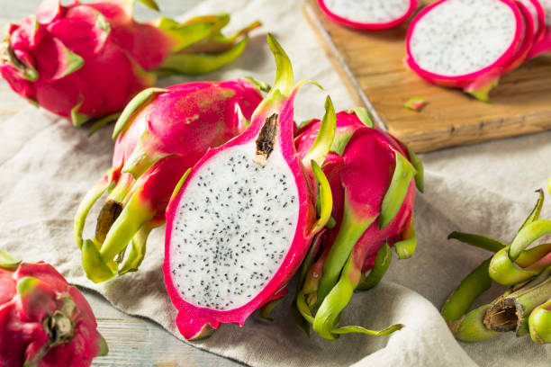 Raw Red Organic Dragon Fruit Raw Red Organic Dragon Fruit in a Bunch pitaya stock pictures, royalty-free photos & images