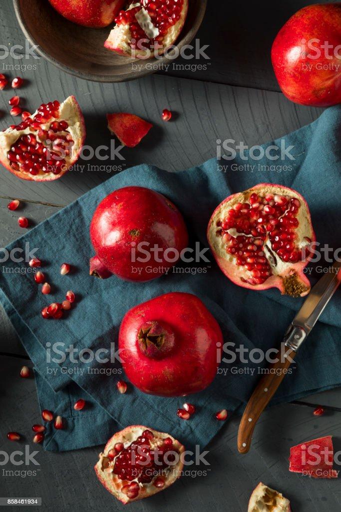 Raw Red Organic Pomegranates stock photo