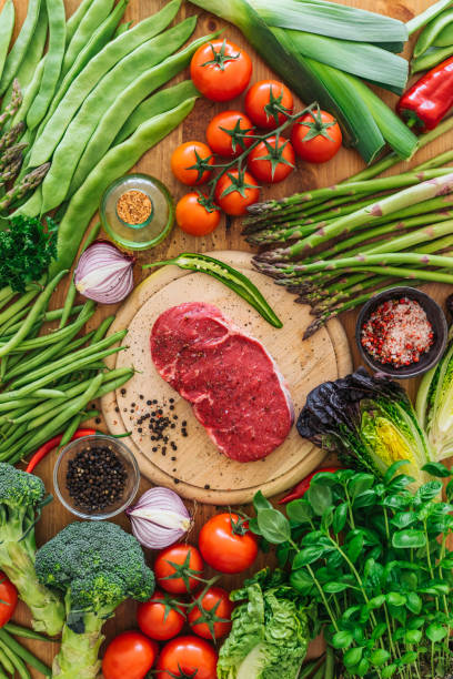 Raw rib eye steak with vegetables stock photo
