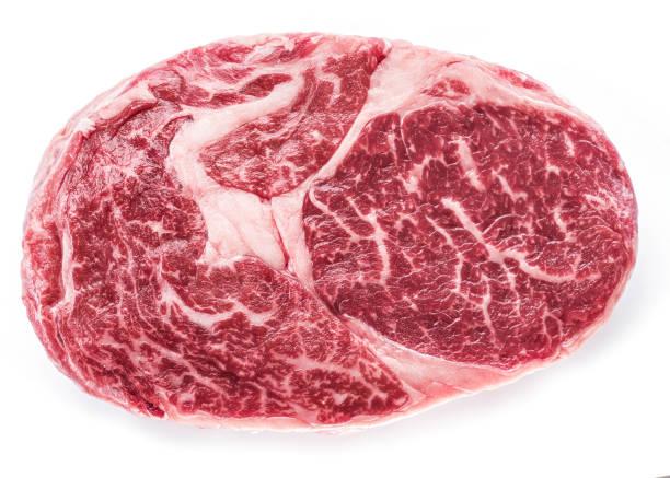 Raw Ribeye steak or beef steak isolated on white background. stock photo