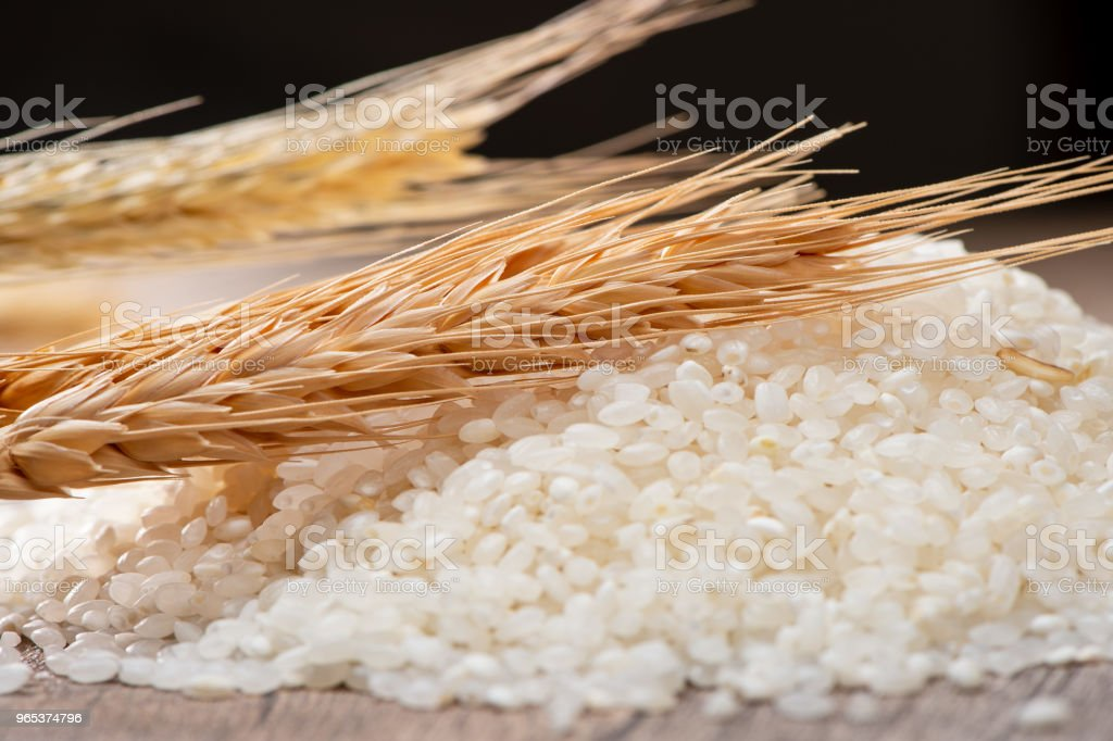 raw rice and wheat on wooden background royalty-free stock photo