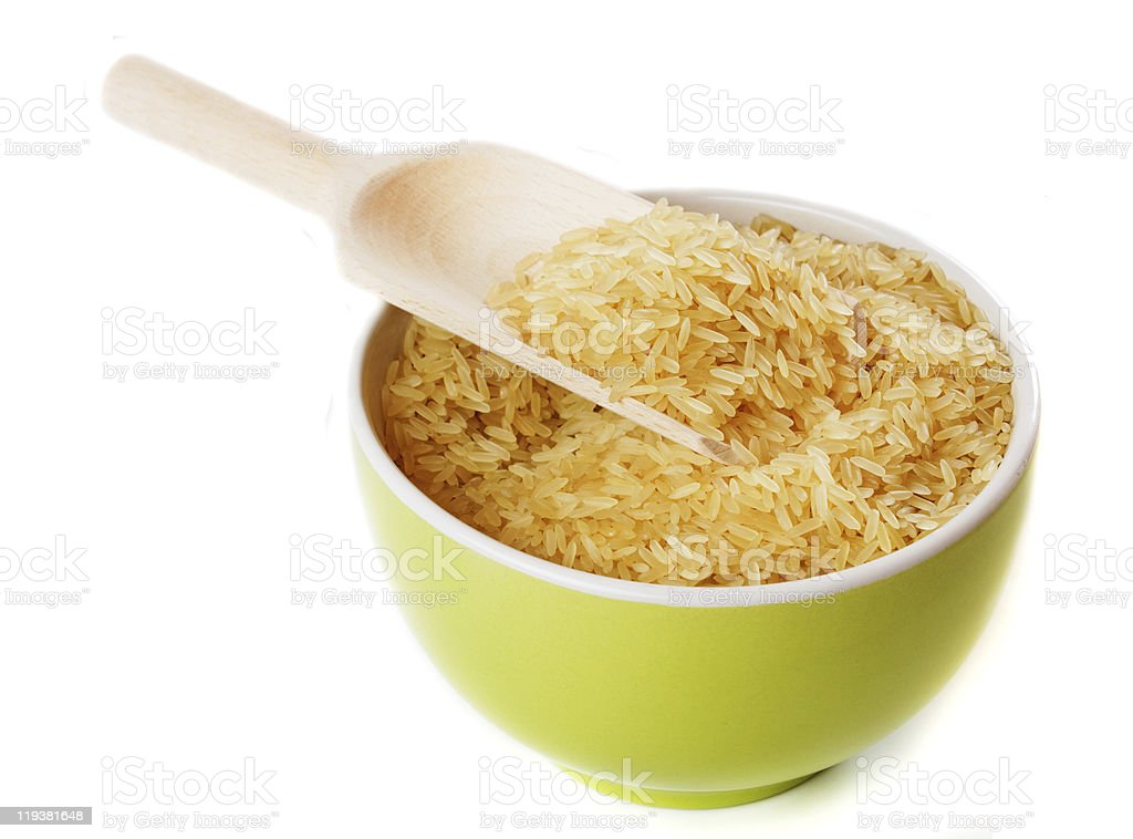 Raw rice in a bowl isolated on white royalty-free stock photo