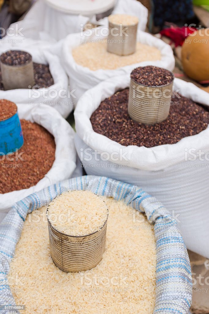 raw rice selling in the market stock photo