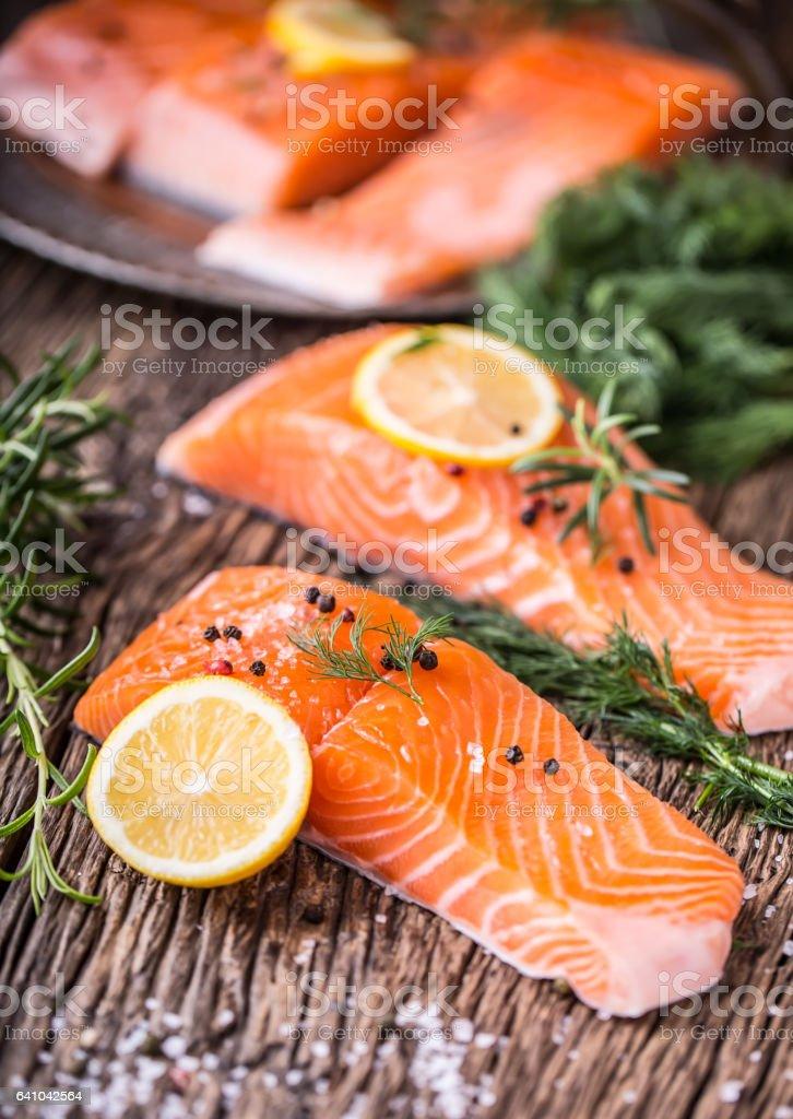 Raw salmon fillet pepper salt dill lemon and rosemary stock photo