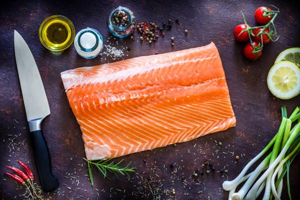 raw salmon fillet ready for cooking shot from above - cortado em filete imagens e fotografias de stock