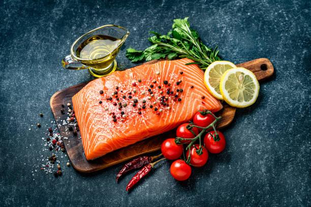 raw salmon fillet with ingredients - salmon imagens e fotografias de stock