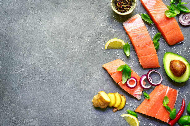 Raw salmon fillet with spice and vegetables stock photo