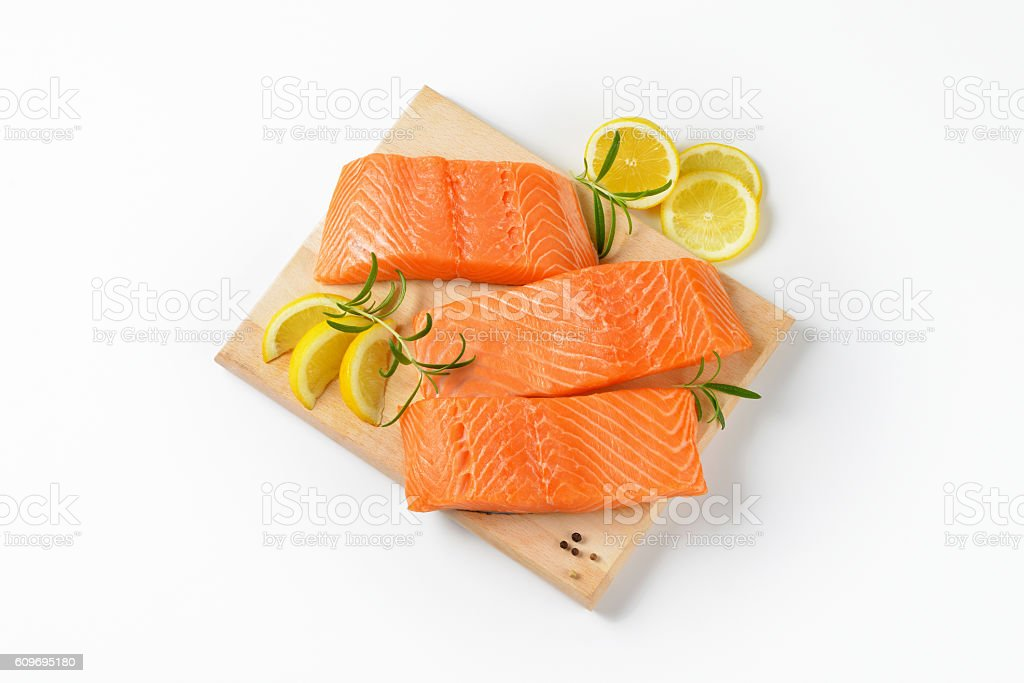 raw salmon fillets stock photo
