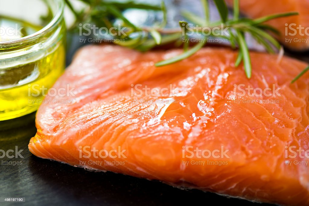 Raw Salmon Fillets with Aromatic Herbs and Olive Oil stock photo