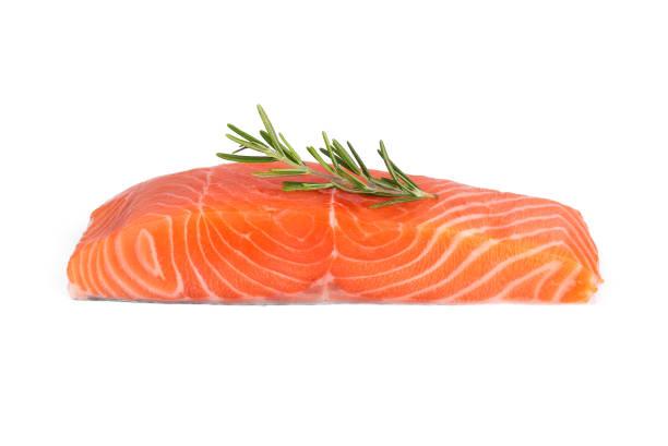 raw salmon piece with rosemary isolated on white background - cortado em filete imagens e fotografias de stock