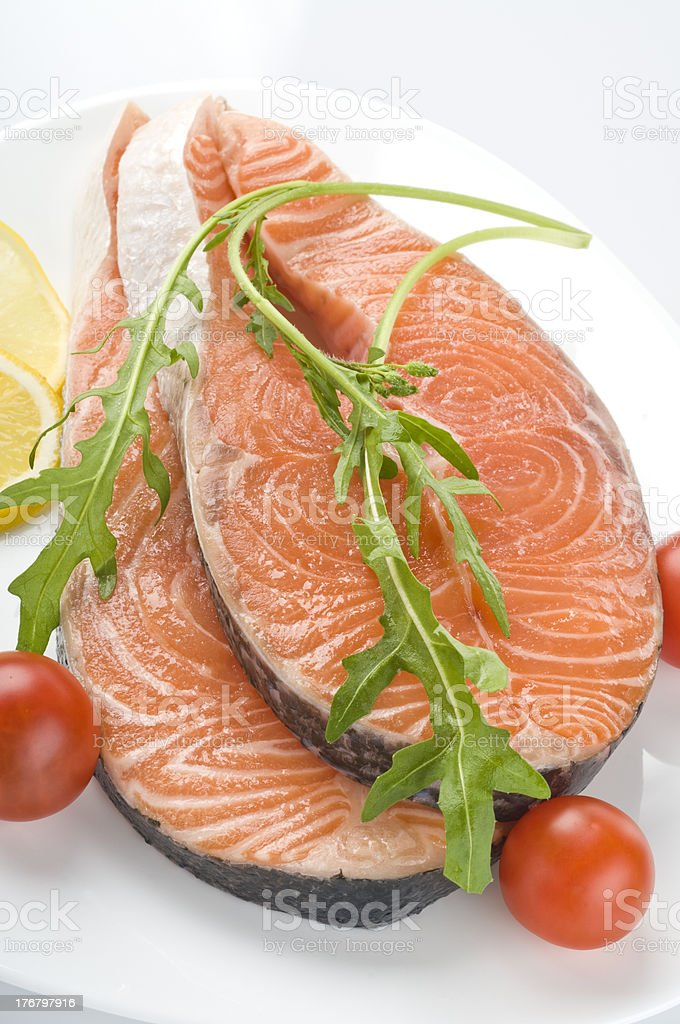 Raw salmon steak with herbs royalty-free stock photo