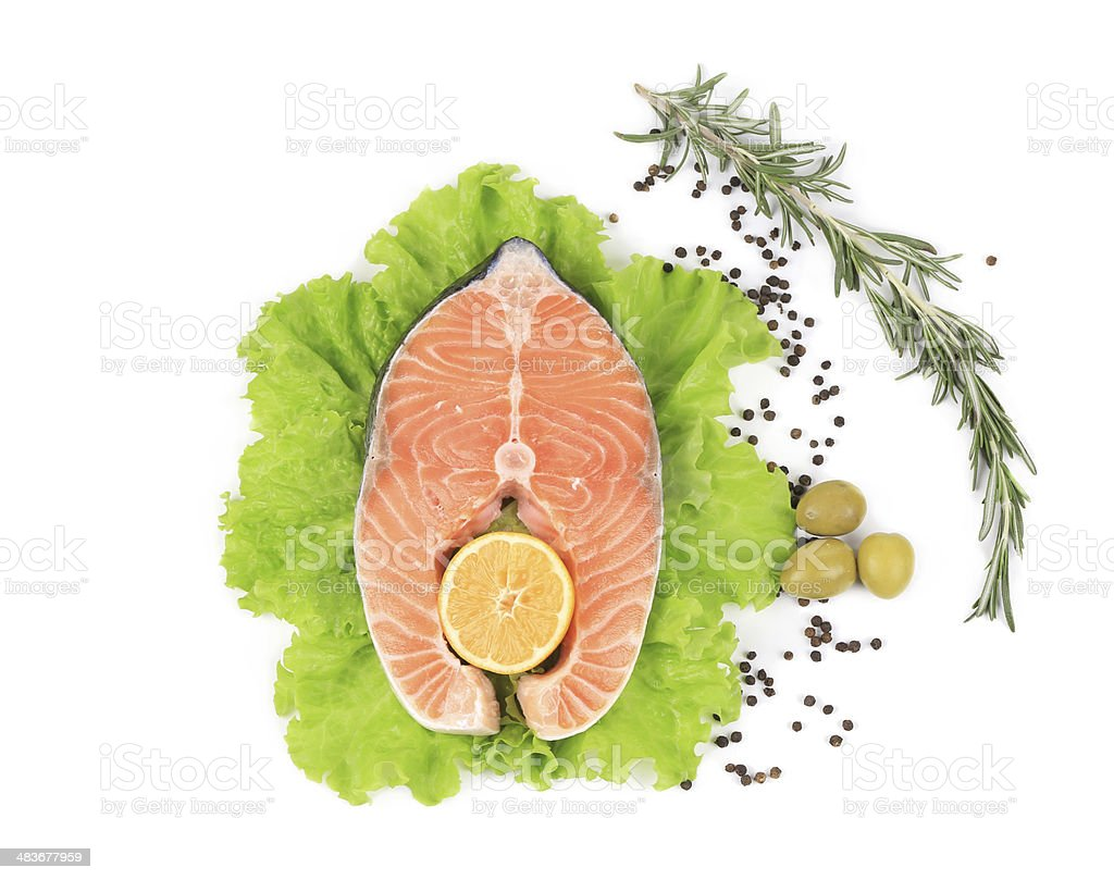 Raw salmon steak with rosemary and lemon. royalty-free stock photo