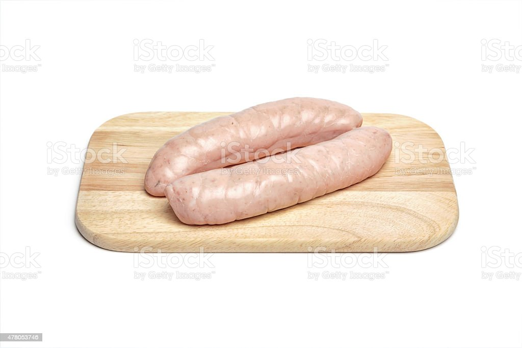 Raw sausage on chopping board stock photo