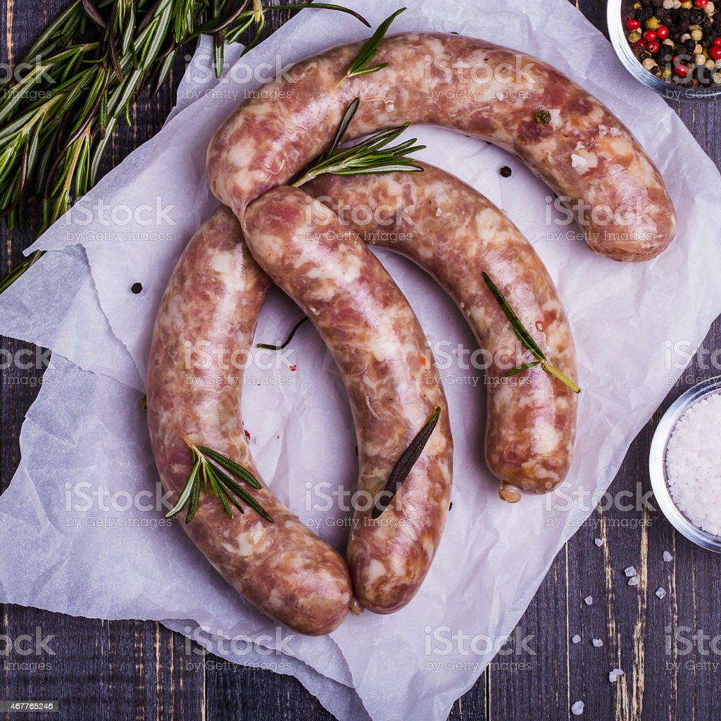 Raw sausage with spices stock photo