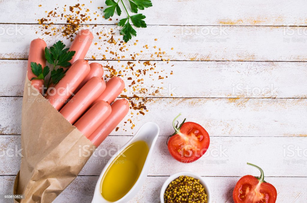 Raw sausages in peel stock photo
