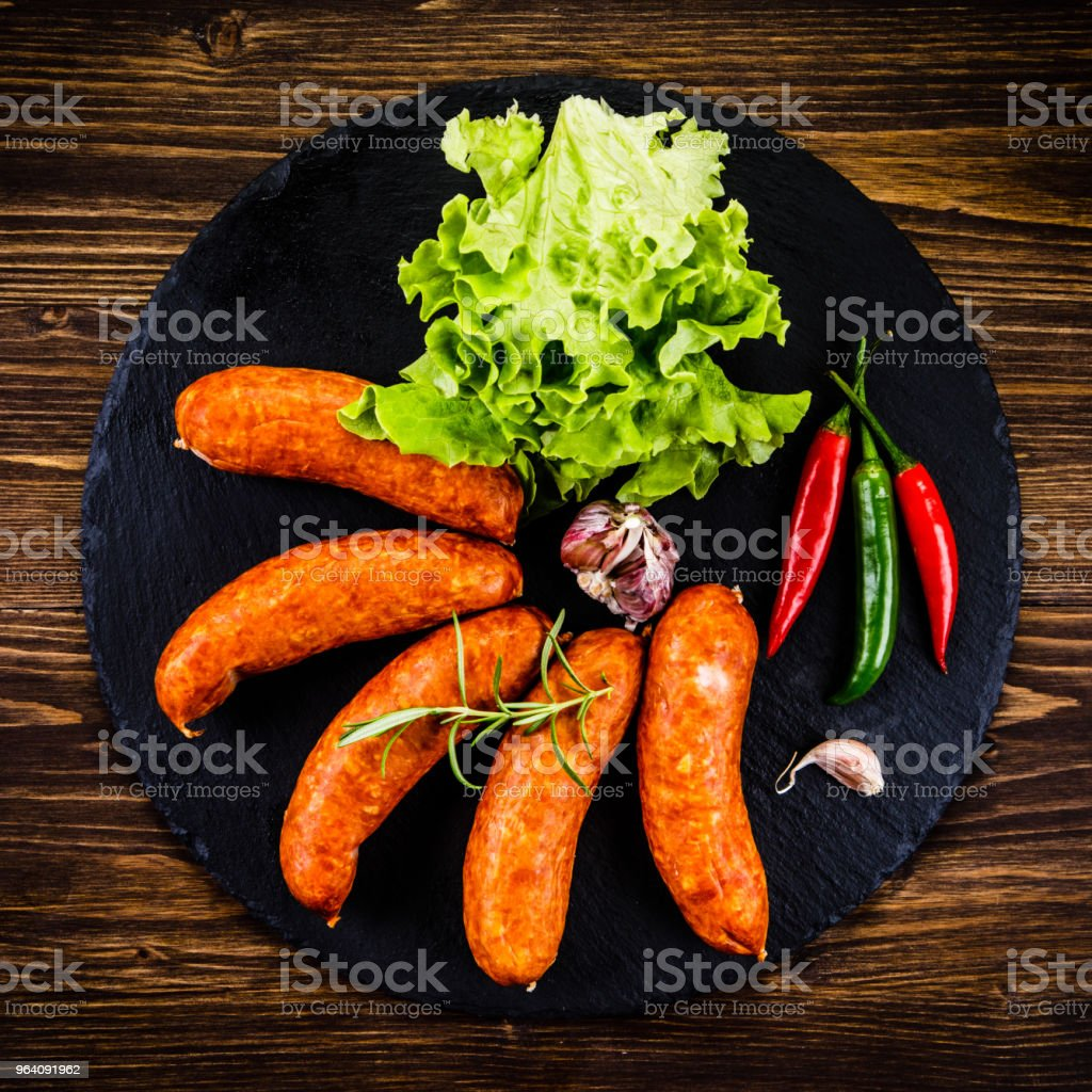 Raw sausages on cutting board - Royalty-free Barbecue Stock Photo