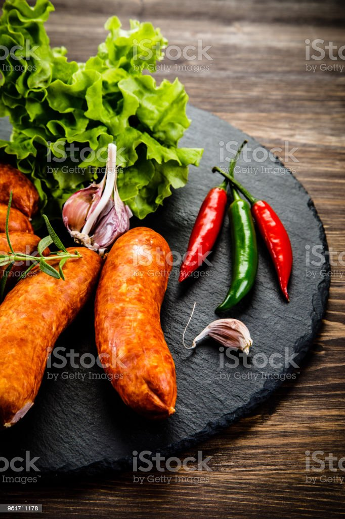 Raw sausages on cutting board royalty-free stock photo