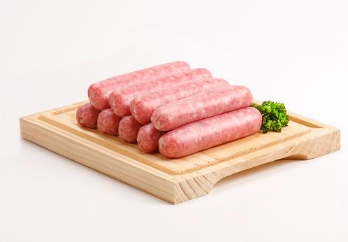 Raw sausages studio shot.