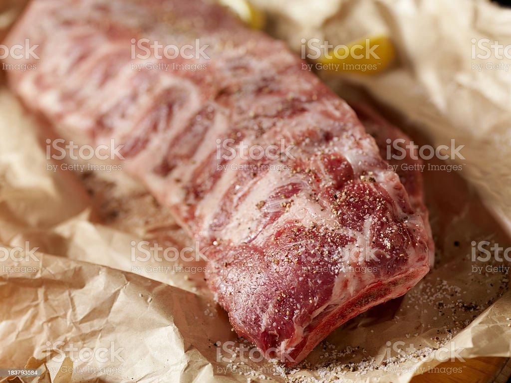 Raw Seasoned Pork Ribs in Butcher Paper royalty-free stock photo