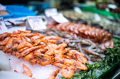 Raw shrimp various kinds background with close-up in La Boqueria Market, Barcelona