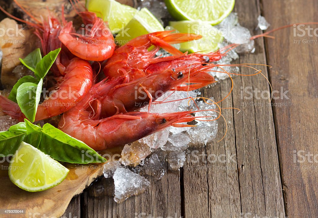Raw shrimps with lime and basil stock photo