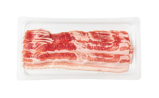 Raw smoked bacon in plastic pack isolated. Streaky brisket slices on tray, fresh thin sliced bacon on white background