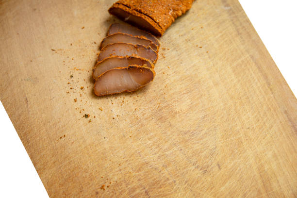 raw smoked meat basturma armenian traditional dish food photography background wooden board for cut textured surface and white symmetry frame work empty copy space for your text here - bresaola foto e immagini stock