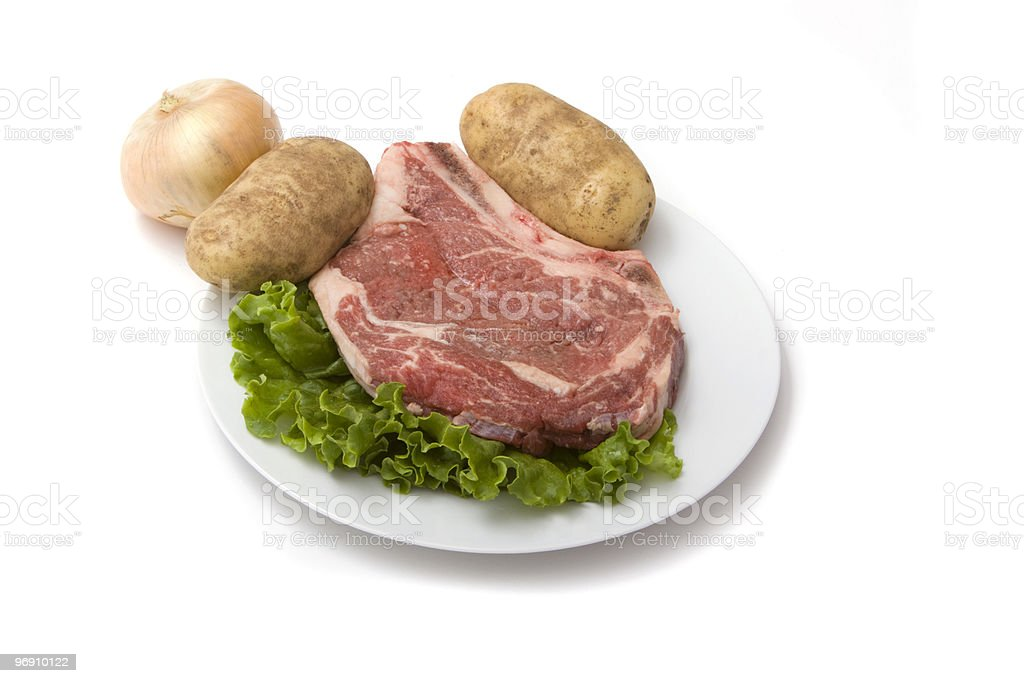 Raw steak and vegetables royalty-free stock photo