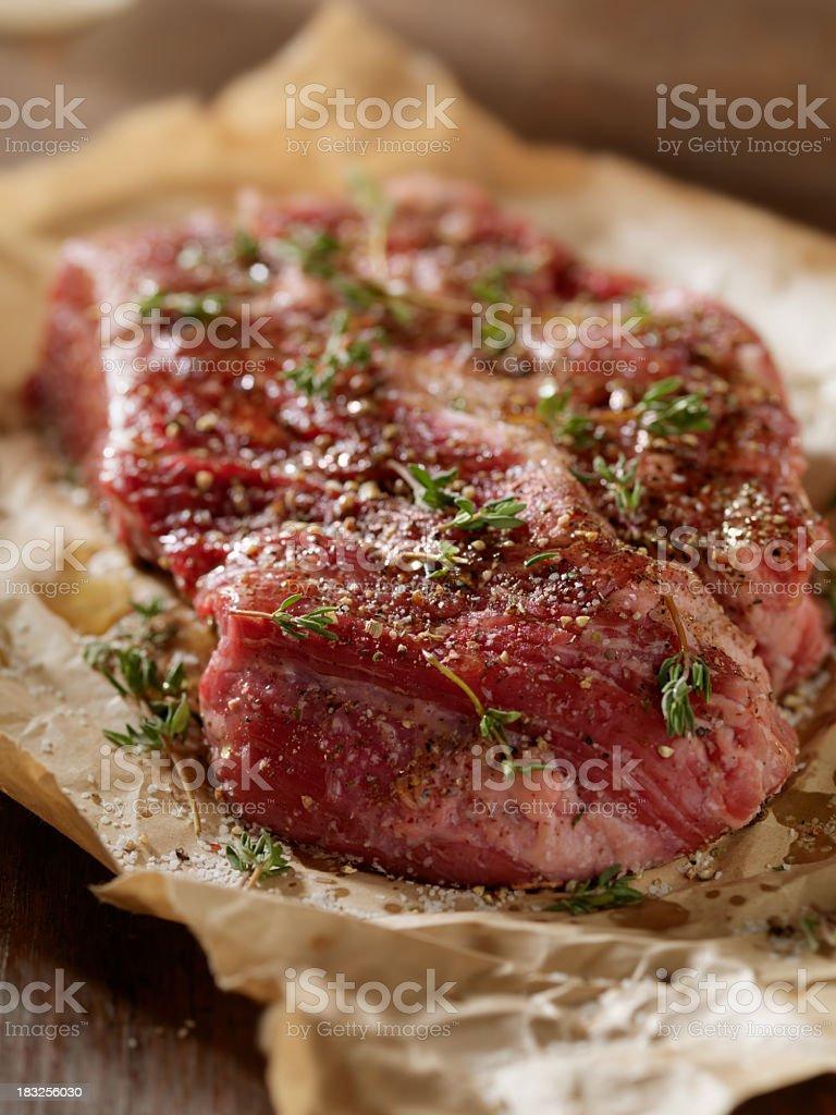 Raw Steak with Fresh Herbs royalty-free stock photo