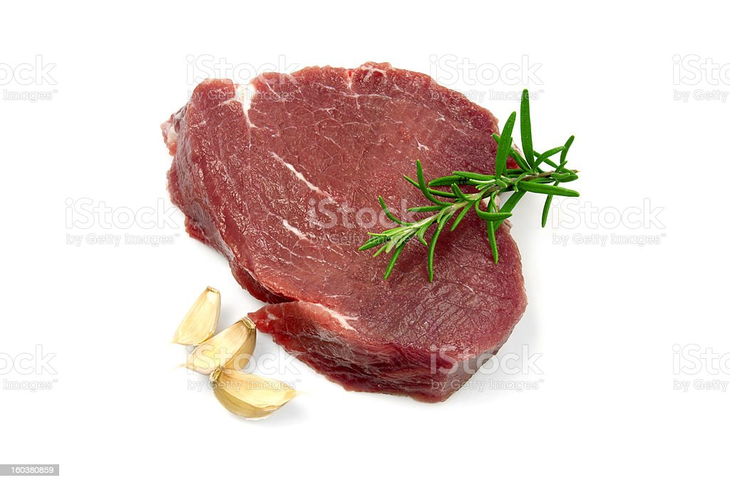 Raw Steak With Garlics stock photo