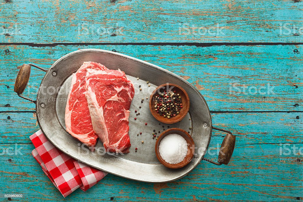 Raw Steaks on Vintage Serving Tray stock photo